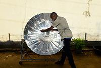 CHAD, N`Djamena , cooking with solar cooker / TSCHAD, Ndjamena, kochen mit Solarkocher