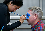 America Brena paints Nick Favero's face during the La Posada Celebration at Western Nevada College, in Carson City, Nev., on Saturday, Dec. 15, 2018. <br /> Photo by Cathleen Allison/Nevada Momentum