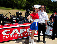 Apr 22, 2014; Kilgore, TX, USA; NHRA top fuel dragster driver Steve Torrence (right) poses for a photo with a member of the Kilgore College Rangerettes at the Torrence estate. Mandatory Credit: Mark J. Rebilas-USA TODAY Sports