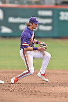 Clemson Tigers shortstop Eli White (4) moves in to start the turn on a double play during a game against the Maine Black Bears at Doug Kingsmore Stadium on February 20, 2016 in Clemson, South Carolina. The Tigers defeated the Black Bears 9-4. (Tony Farlow/Four Seam Images)