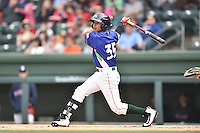 Greenville Drive shortstop Jeremy Rivera (35) swings at a pitch during a game against the Asheville Tourists at Fluor Field on April 10, 2016 in Greenville South Carolina. The Drive defeated the Tourists 7-4. (Tony Farlow/Four Seam Images)
