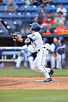 Asheville Tourists designated hitter Kyle Datres (3) swings at a pitch during game one of a double header against the Charleston RiverDogs at McCormick Field on April 9, 2019 in Asheville, North Carolina. The Tourists defeated the RiverDogs 17-3. (Tony Farlow/Four Seam Images)