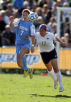 SAN DIEGO, CA - DECEMBER 02, 2012:  Kealia Ohai (7) of the University of North Carolina goes for the ball against Whitney Church (17) of Penn State University during the NCAA 2012 women's college championship match, at Torero Stadium, in San Diego, CA, on Sunday, December 02 2012. Carolina won 4-1.