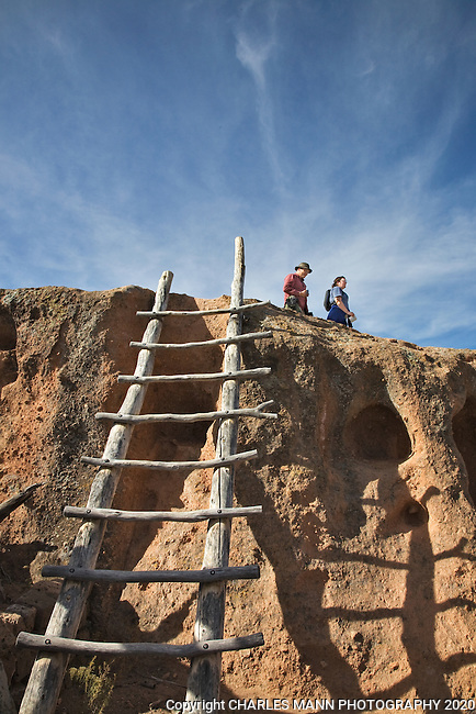 Hikers on the Tsankawi Pueblo trail near the towns of Los Alamos and White Rock start the hike by climbing up a short ladder to the mesa ledge.