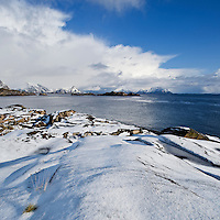 Snow covered rocky coastline at Stamsund, Vestvågøy, Lofoten islands, Norway
