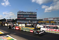 Aug 15, 2014; Brainerd, MN, USA; NHRA top fuel dragster driver Terry McMillen (near lane) races alongside Leah Pritchett during qualifying for the Lucas Oil Nationals at Brainerd International Raceway. Mandatory Credit: Mark J. Rebilas-