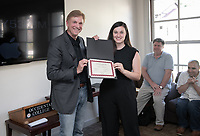 Claire Krelitz '19 is presented the Douglas McAdam Award by Douglas McAdam '73.<br /> Students, faculty and staff gather on Thursday, May 2, 2019 in the JSC Morrison Lounge for the Sociology Senior Comps presentations, awards ceremony, and year-end celebration.<br /> (Photo by Marc Campos, Occidental College Photographer)