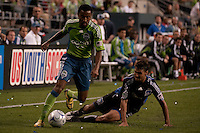 James Riley (l) drives against a san Jose player (r) in the Seattle Sounders 2-1 win against San Jose Earthquake on Saturday, June 13, 2009 at Quest Field in Seattle, WA.