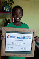 Khayelitsha, South Africa March 5, 2013: Palesa, a young soccer player with a certificate in her home next to the grounds of Amandla EduFootball program. It was founded by Jakob Schlichtig, Florian Zech outside the field in Khayelitsha a poor township outside Cape Town, South Africa. They use football to initiate, support educational projects for youth in the township. The program keep children busy and it decreases the risk of them joining gang, criminal activity or teenage pregnancy. The crime level has decreased substantially in the area since the program was created in 2006. (Photo by: Per-Anders Pettersson)