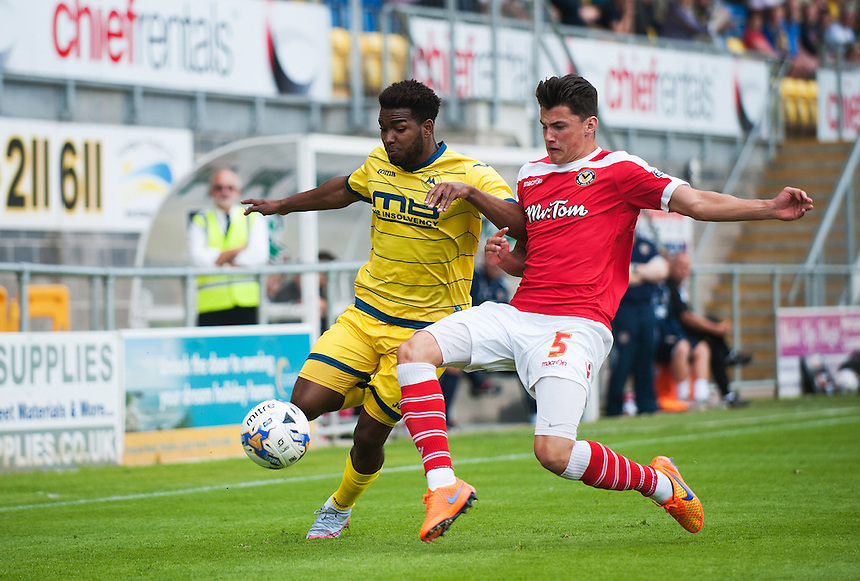 Torquay United's Tyrone Marsh is tackled by Newport County's Regan Poole<br /> <br /> Photographer Kevin Barnes/CameraSport<br /> <br /> Football - Pre Season Friendly - Torquay United v Newport County AFC - Saturday 18th July 2015 - Plainmoor - Torquay<br /> <br /> &copy; CameraSport - 43 Linden Ave. Countesthorpe. Leicester. England. LE8 5PG - Tel: +44 (0) 116 277 4147 - admin@camerasport.com - www.camerasport.com