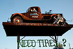 FoxFire Farm old Ford pickup on a tower sign: Need Tires? Jackson Tire Service, Cathage, Missouri.