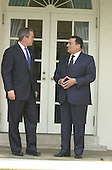 United States President George W. Bush and President Hosni Mubarak of Egypt pause for a photo as they walk down the Colonnade from the Oval Office to the Residence at the White House following their meeting in the Oval Office on Monday, April 2, 2001..Credit: Ron Sachs / CNP