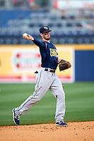 New Orleans Baby Cakes shortstop J.T. Riddle (10) throws to first base during a game against the Nashville Sounds on April 30, 2017 at First Tennessee Park in Nashville, Tennessee.  The game was postponed due to inclement weather in the fourth inning.  (Mike Janes/Four Seam Images)