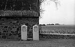 Antique gas pumps out outside a farm near Korsør, Denmark.