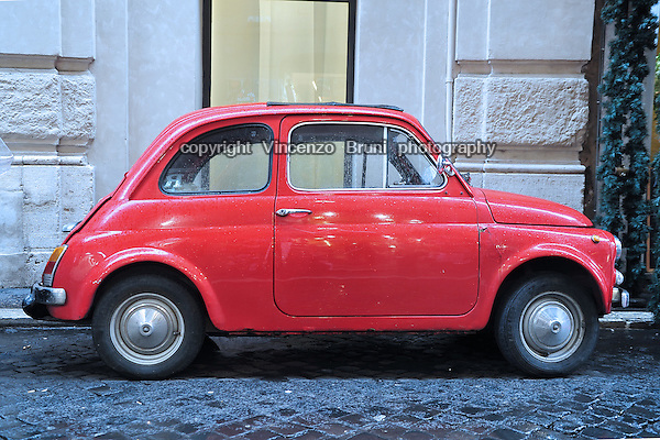 A flashing red 1960's Fiat 500