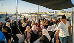 Palestinians make their way through Qalandia checkpoint to attend the last Friday prayer of the holy fasting month of Ramadan in Jerusalem's Al-Aqsa mosque, near Ramallah in the occupied West Bank, on June 8, 2018. Ramadan is sacred to Muslims because it is during that month that tradition says the Koran was revealed to the Prophet Mohammed. The fast is one of the five main religious obligations under Islam. Muslims around the world will mark the month, during which believers abstain from eating, drinking, smoking and having sex from dawn until sunset. Photo by Eyad Jadallah