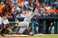 Detroit Tigers outfielder Don Kelly (32) slides home and scores during the second inning of the MLB baseball game against the Houston Astros on May 3, 2013 at Minute Maid Park in Houston, Texas. Detroit defeated Houston 4-3. (Andrew Woolley/Four Seam Images).