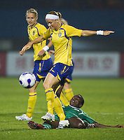 Nigeria forward (18) Cynthia Uwak is stripped of the ball by Sweden defender (6) Sara Thunebro. Sweden (SWE) tied Nigeria (NGA) 1-1 during a FIFA Women's World Cup China 2007 opening round Group B match at Chengdu Sports Center Stadium, Chengdu, China, on September 11, 2007.