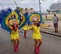 TAE- Carnival Parade with HAL Koningsdam at Pier in Background - S. Caribbean , Oranjestad Aruba