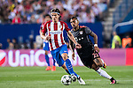 Filipe Luis of Atletico Madrid runs past Arturo Vidal of FC Bayern Munich during their 2016-17 UEFA Champions League match between Atletico Madrid vs FC Bayern Munich at the Vicente Calderon Stadium on 28 September 2016 in Madrid, Spain. Photo by Diego Gonzalez Souto / Power Sport Images