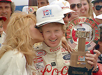 NASCAR Winston Cup driver Bill Elliott gets a victory kiss after winning  the Pepsi Firecracker 400 at Daytona International Speedway in Daytona Beach, FL on July 2, 1988.  (Photo by Brian Cleary/bcpix.com)