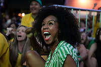 Beautiful black woman in ecstasy - soccer fans watching the 2014 Brazil World Cup matches at FIFA Fan Fest in Copacabana beach, Rio de Janeiro, Brazil.