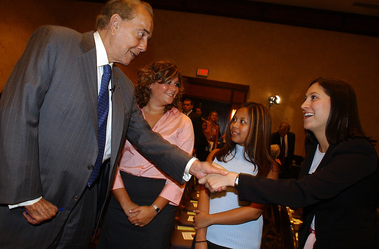 "Former Sen. Bob Dole, R-Kan., greets Christy Hahn of the Parkison's Action Network, as JoAnn Dulay, right, and Koryn Ruin of WomenHeart, look on, before a news conference to kick-off his nationwide speaking tour to promote Part D of the new Medicare Prescription Drug Benefit.  Dole reveiwed a list of ""10 Things Seniors Need to Know"", an educational pamphlet that explains the details of the Medicare Drug Benefit in easy to understand language."