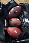 Nike footballs with the Wake Forest logo sit in an equipment bag prior to the game against the Louisville Cardinals at BB&T Field on October 28, 2017 in Winston-Salem, North Carolina.  The Demon Deacons defeated the Cardinals 42-32.  (Brian Westerholt/Sports On Film)