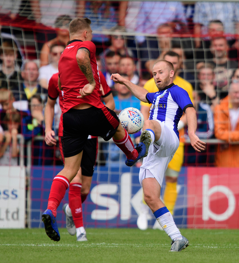 Sheffield Wednesday's Barry Bannan vies for possession with Lincoln City's Harry Anderson<br /> <br /> Photographer Chris Vaughan/CameraSport<br /> <br /> Football Pre-Season Friendly - Lincoln City v Sheffield Wednesday - Saturday July 13th 2019 - Sincil Bank - Lincoln<br /> <br /> World Copyright © 2019 CameraSport. All rights reserved. 43 Linden Ave. Countesthorpe. Leicester. England. LE8 5PG - Tel: +44 (0) 116 277 4147 - admin@camerasport.com - www.camerasport.com