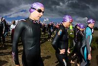 20 JUL 2008 - MANLEY, UK - Competitors head for the swimstart - Deva Divas Triathlon. (PHOTO (C) NIGEL FARROW)