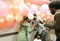 Kea Jones (from left), Obafemi Ajibola and Sherif Sharfadine, all graduate students at the  University of Arkansas, hang balloons as a backdrop Tuesday, February 11, 2020, for the Valentine's Day Photo shoot hosted by UARK-Minorities in Agriculture, Natural Resources and Related Sciences at the Arkansas Union on the campus in Fayetteville. Funds raised by the event towards travel and registration the national conference and other chapter activities. Check out nwaonline.com/200212Daily/ and nwadg.com/photos for a photo gallery.<br /> (NWA Democrat-Gazette/David Gottschalk)