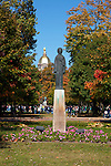 Entrance to the University of Notre Dame with statue to the Holy Mother and the Dome atop the Administration Building.