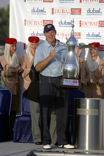 6 March 2005: South African golfer Ernie Els (RSA) lifts the trophy during the prize presentation after victory at the Dubai Desert Classic held on the Majlis Course at the Emirates Golf Club, Dubai, United Arab Emirates. Els won by one stroke after finishing on 19 under par. Photo: Neil Tingle/Action Plus..050306 male man men golf golfer golfers win winners winner celebrations celebration celebrates celebrate joy celebrating