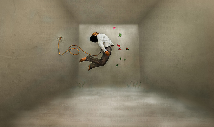 Conceptual image of a young male figure floating in a room