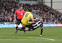 Shaun Byrne and Danny Mullen collide in the St Mirren v Livingston Scottish Professional Football League Ladbrokes Championship match played at the Paisley 2021 Stadium, Paisley on 14.4.18.