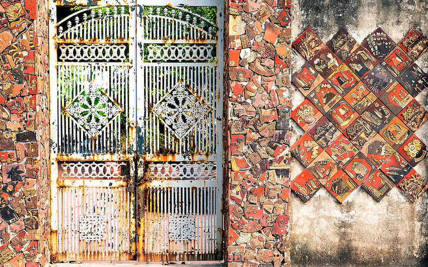 A Decorated Gate In this small traditional Pottery Village about 2 hours drive north of Hanoi people producing clay coffins, Urns, Pots and other stone ware. Vietnam
