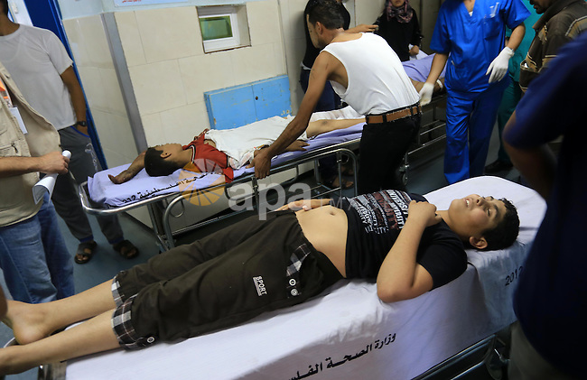 A Palestinian man, wounded following an Israeli air strike, receives treatment at al-Shifa hospital in Gaza City on July 25, 2014. An Israeli defense official says the Israeli Security Cabinet is meeting to discuss international cease-fire efforts, but also the option of expanding its forces' eight-day-old ground operation in Gaza. Photo by Mohammed Asad