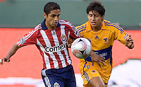 Chivas USA defender Mariano Trujillo battles Tigres de UANL defender Jorge Valencia. Los Tigres de UANL defeated the Chivas USA 2-1 during a 2009 SuperLiga match at Home Depot Center stadium in Carson, California on Saturday evening June 20, 2009.   .