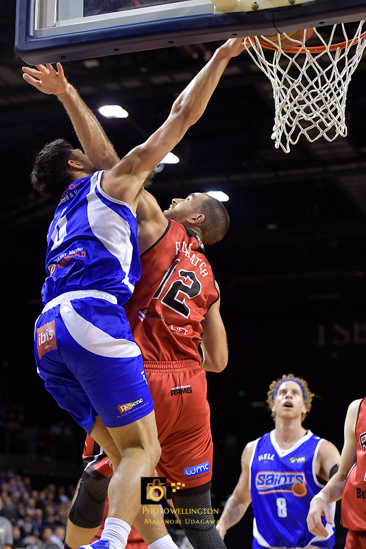 Saints' Shea Ili and Rams' Ethan Rusbatch in action during the NBL - Wellington Saints v Canterbury Rams   at TSB Bank Arena, Wellington, New Zealand on Saturday 8 April 2017.<br /> Photo by Masanori Udagawa<br /> www.photowellington.photoshelter.com.