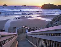 Stairs to beach at Bandon at sunset, Oregon