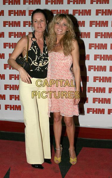 DANIELLE BRENT.FHM 100 Sexiest Women Party, Guildhall, .London,.3rd June 2004..full length full-length  pink flowery floral dress yellow bag shoes.www.capitalpictures.com.sales@capitalpictures.com.©Capital Pictures