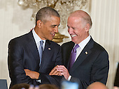 United States President Barack Obama, left, and US Vice President Joe Biden, right, share smiles as the President is introduced prior to his making remarks at a reception for the 25th Anniversary of the White House Initiative on Educational Excellence for Hispanics in the East Room of the White House in Washington, DC on Thursday, October 15, 2015.<br /> Credit: Ron Sachs / Pool via CNP