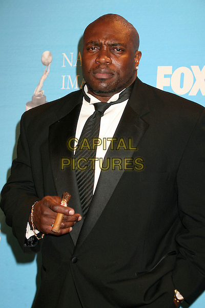 LESTER SPEIGHT.38th Annual NAACP Image Awards at the Shrine Auditorium - Press Room, Los Angeles, California, USA, .2 March 2007..half length smoking cigar.CAP/ADM/BP.©Byron Purvis/AdMedia/Capital Pictures.