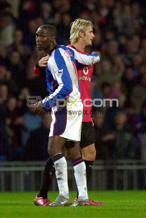 Pix: Ben Duffy/SWpix.com....Football......Barclaycard Premiership....Blackburn Rovers v Manchester United's....22/12/2002..COPYRIGHT PICTURE>>SIMON WILKINSON>>01943 436649>>..Unites past and present....Blackburn's Andrew Cole and Manchester's David Beckham share a hug after Blackburns win