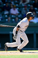 Right fielder Leonardo Molina (20) of the Charleston RiverDogs bats in a game against the Greenville Drive on Sunday, April 29, 2018, at Fluor Field at the West End in Greenville, South Carolina. Greenville won, 2-0. (Tom Priddy/Four Seam Images)