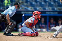 Reading Fightin Phils catcher Austin Bossart (18) blocks a ball in the dirt in front of home plate umpire Derek Gonzales during the second game of a doubleheader against the Portland Sea Dogs on May 15, 2018 at FirstEnergy Stadium in Reading, Pennsylvania.  Reading defeated Portland 9-8.  (Mike Janes/Four Seam Images)