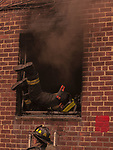 Firefighter Adam Bishop of Towerr Ladder 170 dives into a first floor apartment window to conduct vent enter search on Feburary, 1, 2018.