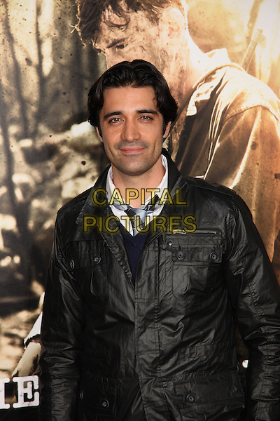 GILLES MARINI.Arrivals to the Los Angeles Premiere of the HBO Miniseries The Pacific at Grauman's Chinese Theatre, Hollywood, CA, USA, February 24th, 2010. .half length black jacket blue tie .CAP/CEL.©CelPh/Capital Pictures.