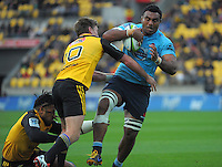 Beauden Barrett and Ma'a Nonu (left) combine to stop Waratahs number eight Wycliff Palu during the Super Rugby match between the Hurricanes and Waratahs at Westpac Stadium, Wellington, New Zealand on Saturday, 18 April 2015. Photo: Dave Lintott / lintottphoto.co.nz