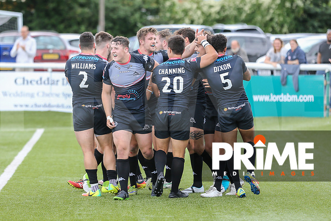 Alex Walker of London Broncos celebrates with team mates after he scores a try during the Kingstone Press Championship match between London Broncos and Featherstone Rovers at Castle Bar , West Ealing , England  on 25 June 2017. Photo by David Horn.